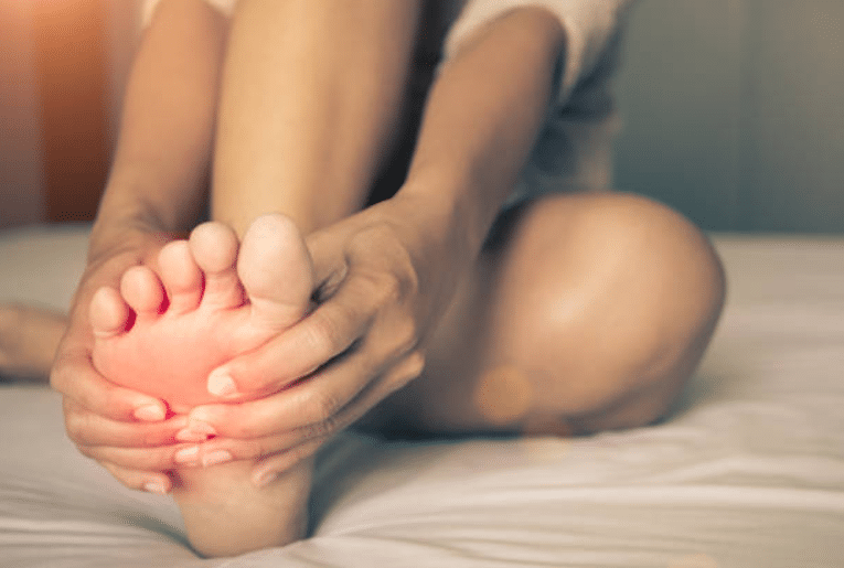 douleur pied jambe massage